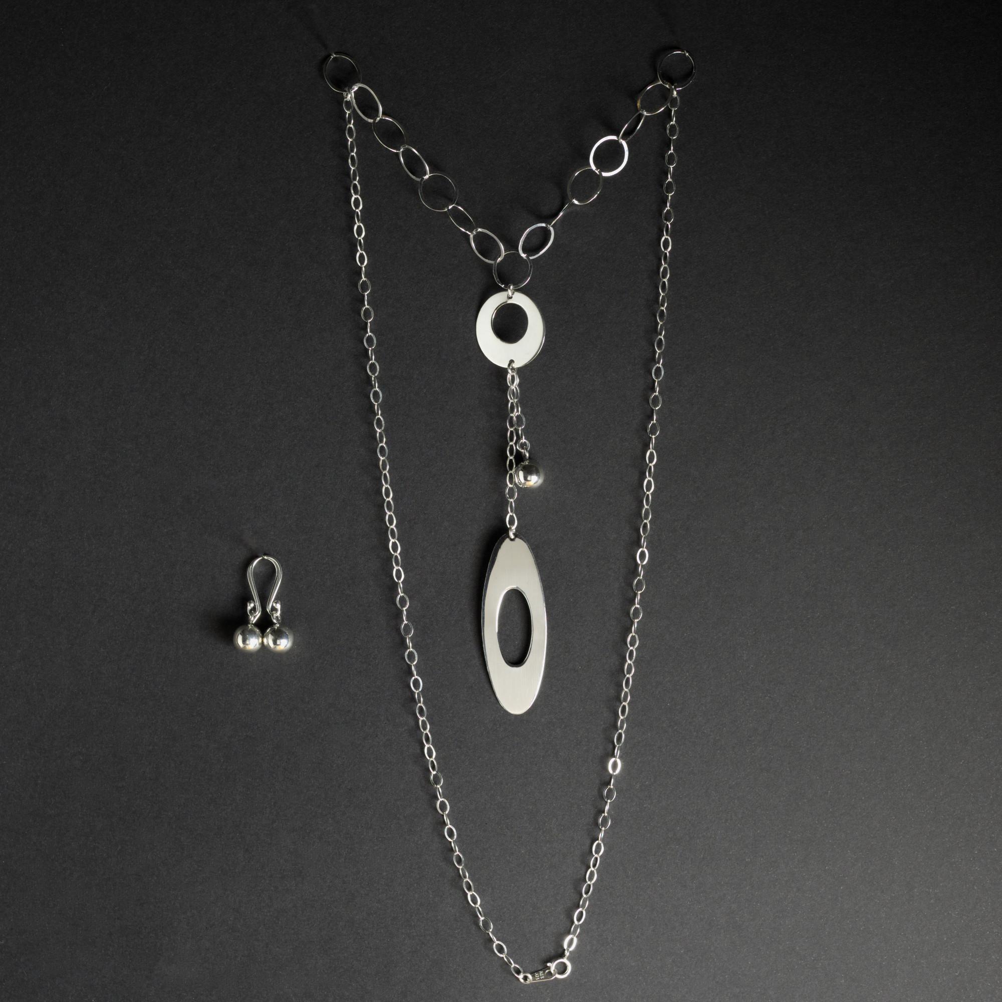 Mirzam: Kombination av halsband, berlock och örhängen. Glansig sterling silver med små och stora ringar, boll.